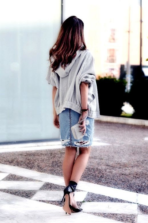 Le Fashion Blog 7 Ways To Style A Distressed Denim Skirt Blogger Style Heroine Slouchy Hooded Grey Gray Jacket Studded Wristlet Clutch Ripped Torn Jean Skirt Ankle Wrap Black Heels 6 photo Le-Fashion-Blog-7-Ways-To-Style-A-Distressed-Denim-Skirt-Style-Heroine-6.jpg