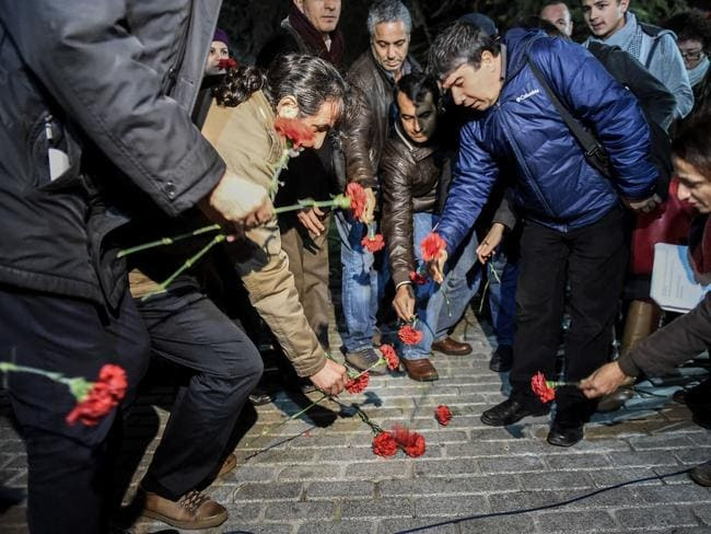 Tribute ... members of the Turkish medical association lay flowers in Istanbul's tourist hub of Sultanahmet where at least 10 people were killed and 15 wounded in a suspected terrorist attack. Picture: AFP/Ozan Kose