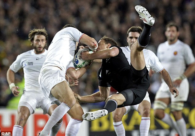 Battle hardened: New Zealand's Israel Dagg and France's Maxime Mermoz compete to win the catch