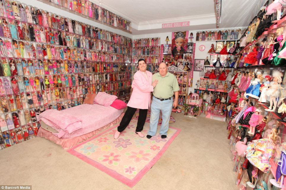 Stanley Colorite and his partner Dennis Schlicker show off just some of their 3,000 Barbie and Ken dolls at their home in Hudson, Florida