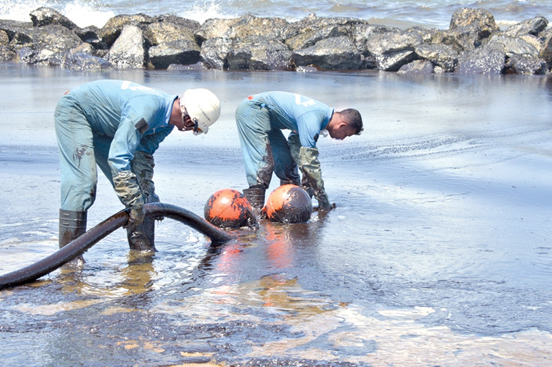 Oil spill clean-up operations in progress