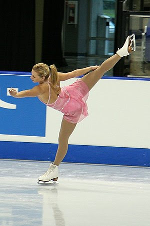 Joannie Rochette performs a spiral at the 2006...