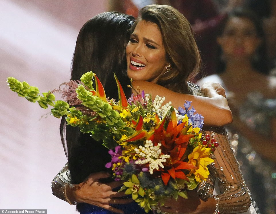 Miss Universe 2016 Iris Mittenaere, right, of France is hugged by Miss Universe 2015 Pia Wurtzbach