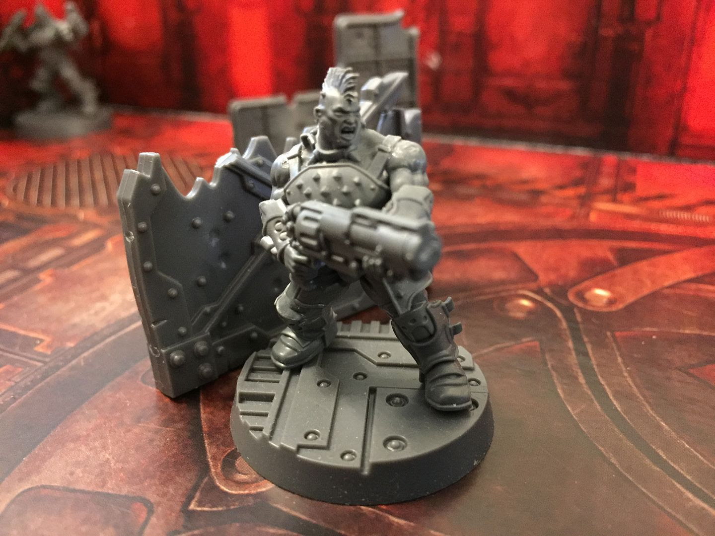 A Goliath lays down suppressing fire in Necromunda: Underhive.