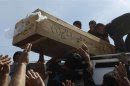 Residents carry the coffin of a victim, who was killed in a bomb attack, during a funeral in Najaf