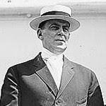 A photograph of Wilson Mizner.