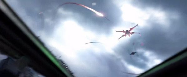 A Resistance X-Wing fighter is about to be struck by a missile above Starkiller Base in STAR WARS: THE FORCE AWAKENS.