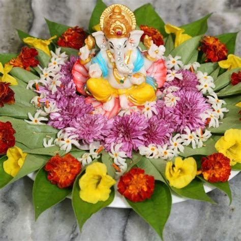 4.Ganesha Betel leaf decoration with flowers   30 Betel