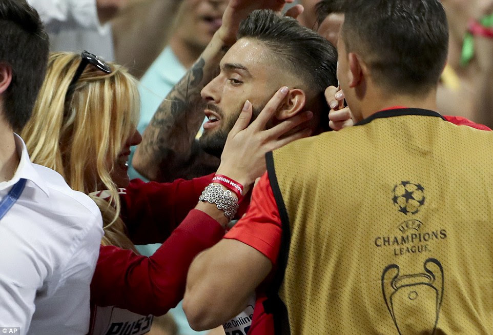 The midfielder joined his girlfriend Noemie Happart on the sidelines to celebrate his goal with a kiss as Atletico showed their resilience