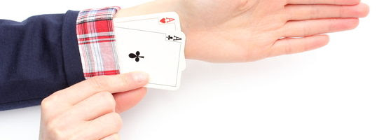 Business woman has an aces up his sleeve. Isolated on white background