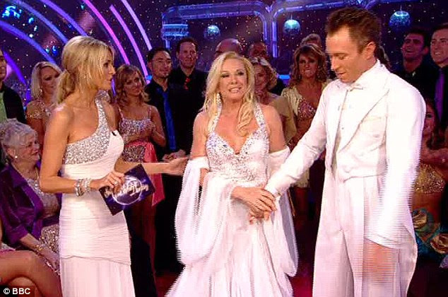 All white on the night: Pamela and James stand with Tess as they await the judges' results