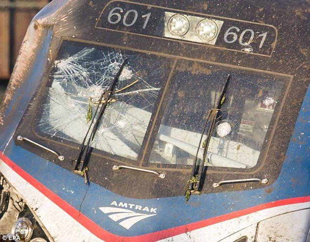 Crack: The FBI is investigating what could have caused the small, focused crack (pictured lower right) on the windshield of the derailed Amtrak train