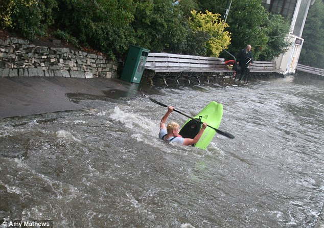 The canoeist appears to be in difficulties as he paddles across Bournemouth pleasure gardens today. This picture was provided by MailOnline reader Amy Matthews