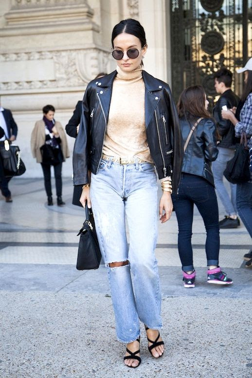Le Fashion Blog Street Style Pfw Round Sunglasses Leather Jacket Neutral Turtleneck High Waisted Vintage Jeans Gold Belt Black Strappy Heeled Sandals Via The Outfit