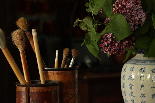 Chinese Brushes and a Vase of Lilacs