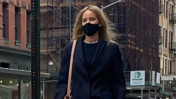 Jennifer Lawrence Makes Rare Appearance Shopping In NYC Wearing A Sleek Black Coat