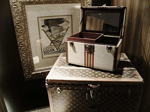 Louis Vuitton trunks and poster