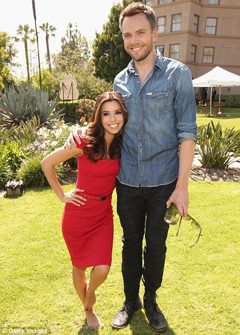 The long and the short of it! Eva Longoria, 5ft 2, and American comedian Joel McHale, 6ft 4, posed for hilarious photo at the NBCUniversal summer press day