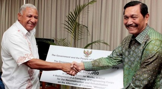 Prime Minister Frank Bainimarama receives a 5 million US dollar cheque from Indonesia's Coordinating Political, Legal and Security Affairs Minister Luhut Pandjaitan.