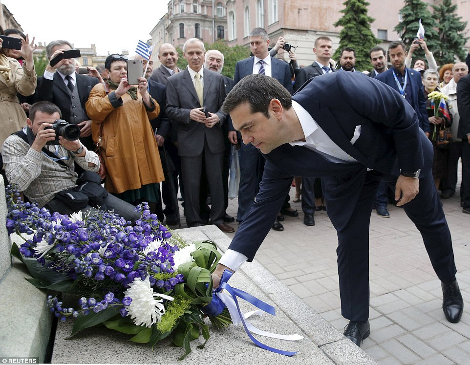 Tribute: Alexis Tsipras places flowers at the statue of the founder of the modern Greek state, Ioannis Kapodistrias, in St Petersburg, Russia