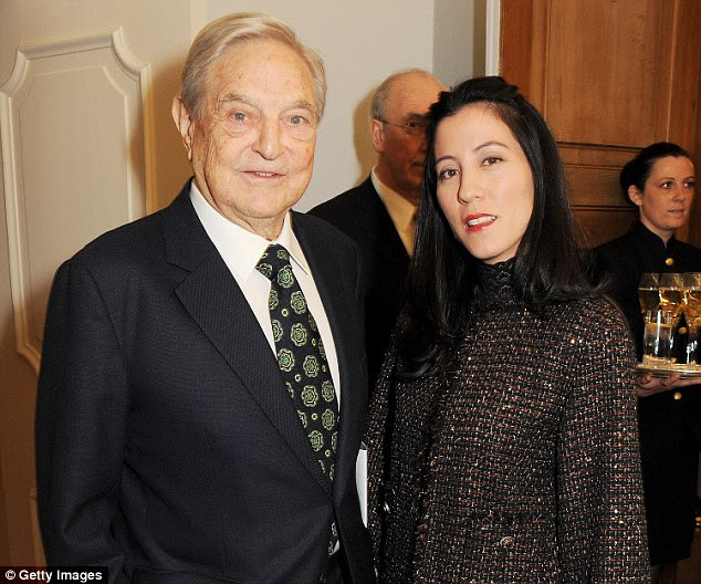 Like father, like son: Robert's 84-year-old father George Soros shares his son's taste in much younger women. He married current wife, 42-year-old Tamiko Bolton, in 2013