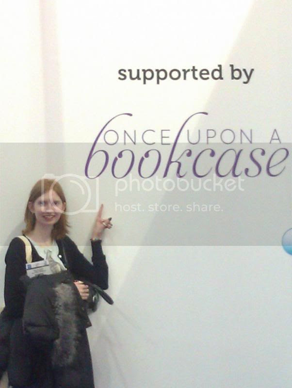 Me with blog logo on wall