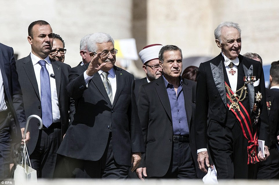 Abbas (pictured second from left) was described as an 'angel of peace' when he and Pope Francis met yesterday