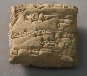 A merchant's receipt for 1500 liters of grain from the Ur III period (2112–2004 BC), written in cuneiform script. Peabody Museum, Harvard: PM 66-27-60/12127.1.