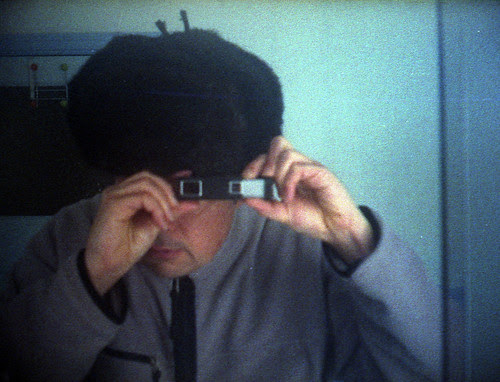 reflected self-portrait with Kiev 30 camera and Russian hat by pho-Tony