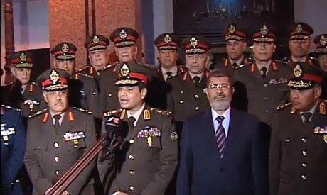 Egyptian President Morsi with military leaders. Tensions have escalated between the government and the army after the kidnapping of seven soldiers in the Sinai. by Pan-African News Wire File Photos