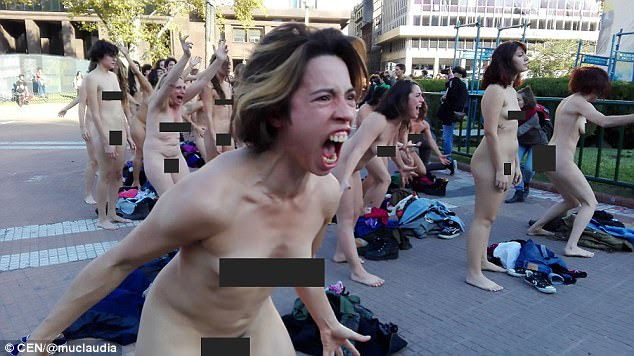 A woman screams angrily as part of the protest against women being made victims of violence
