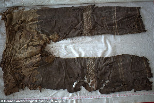 What are thought to be the world's oldest trousers (pictured) have been discovered in one of the Yanghai tombs in China's Tarim Basin. The trousers are made of three bits of cloth, one for each leg and one for the crotch, stitched together. A woven decoration is also visible on the trousers, thought to have been used for horse riding