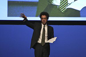 Picture of {{w|Malcolm Gladwell}}. Full set fr...