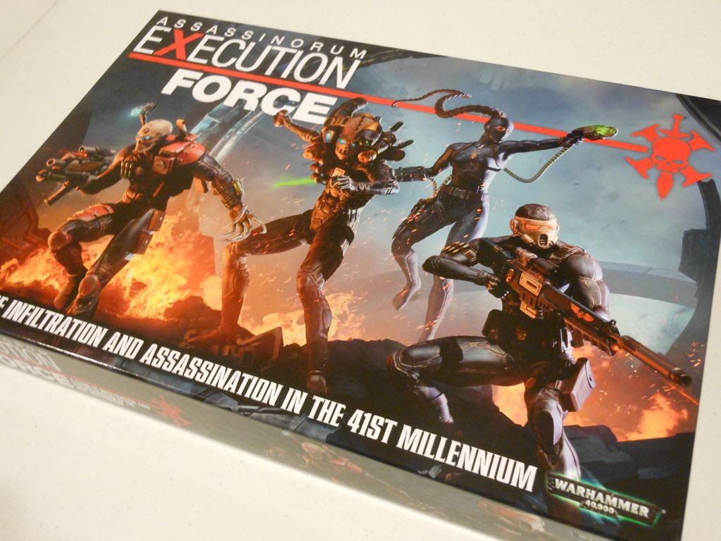 Assassinorum: Execution Force board game box, showing detail of the front cover artwork with four assassins leaping into action, firing futuristic guns, with explosions behind.