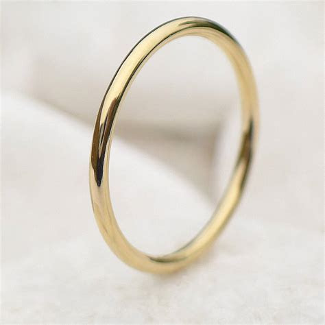 slim halo wedding ring in 18ct gold by lilia nash