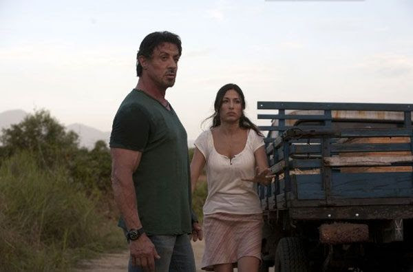 Sylvester Stallone has to rescue an evil dictator's daughter (Giselle Itié) in THE EXPENDABLES.