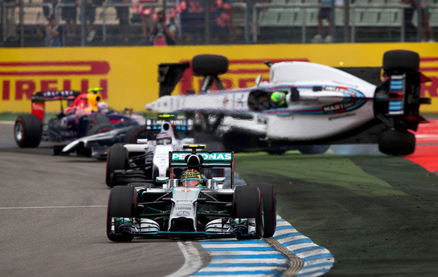 Nico Rosberg leads as Felipe Massa gets flipped upside-down behind him