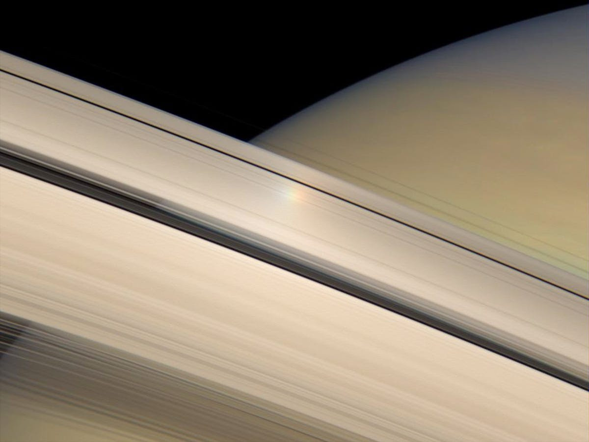 Just like ice in Earth's atmosphere, Saturn's rings can produce rainbow-hued halos.