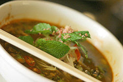 A bowl of Penang laksa, a variant of assam laksa.