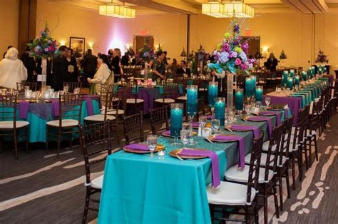 teal, purple, and gold reception decor   Quince ideas
