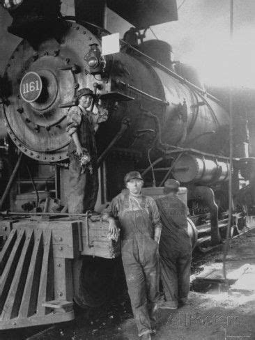 Women Rail Workers Standing at Work on Engine of Train