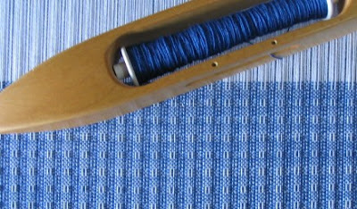 Huck towel on the loom.  8/2 cotton, white warp & royal blue weft.