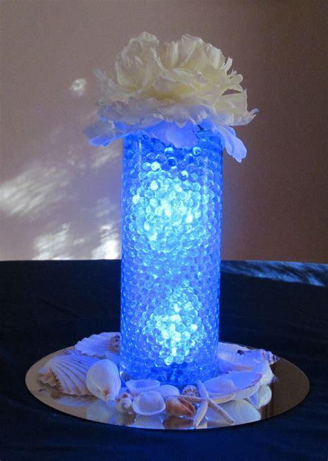 Sample Centerpiece   blue water beads, clear light inside