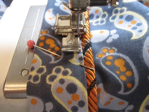 Topstitch In Place Close to Piping