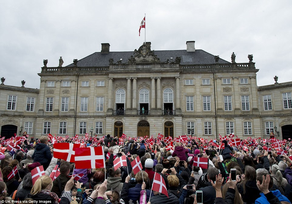 Delighted: When Queen Margrethe emerged onto the balcony, the cheers grew even louder
