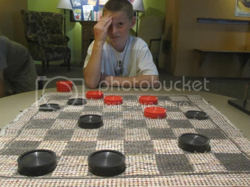 Ryan trying to figure out how he is going to beat me at checkers.  (He did by the way and I don't let kids win.)