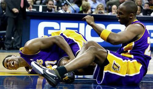 Kobe Bryant watches as Andrew Bynum writhes in pain on the floor, after the two collide during the game against the Memphis Grizzlies on January 31, 2009.
