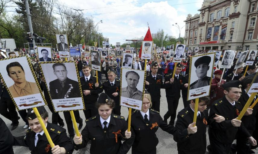 People hold pictures of World War Two soldiers as they take part in the Immortal Regiment march in Rostov-on-Don, Russia. REUTERS/Host Photo Agency/RIA Novosti