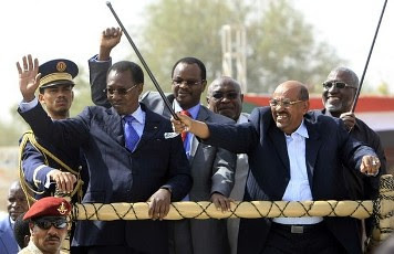 Chad's President Idriss Deby and Sudan's President Omar Hassan al-Bashir wave to the crowd after launching the Darfur Regional Authority in El Fasher, February 8, 2012. The new regional body will promote development and be responsible for the governance. by Pan-African News Wire File Photos