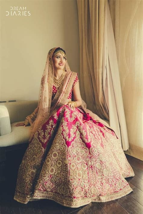 Beautiful Pink and gold bridal lehenga with light peach